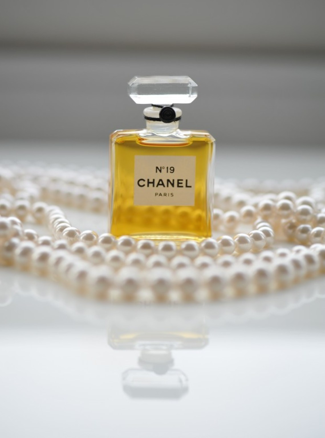Chanel No. 19 and pearls