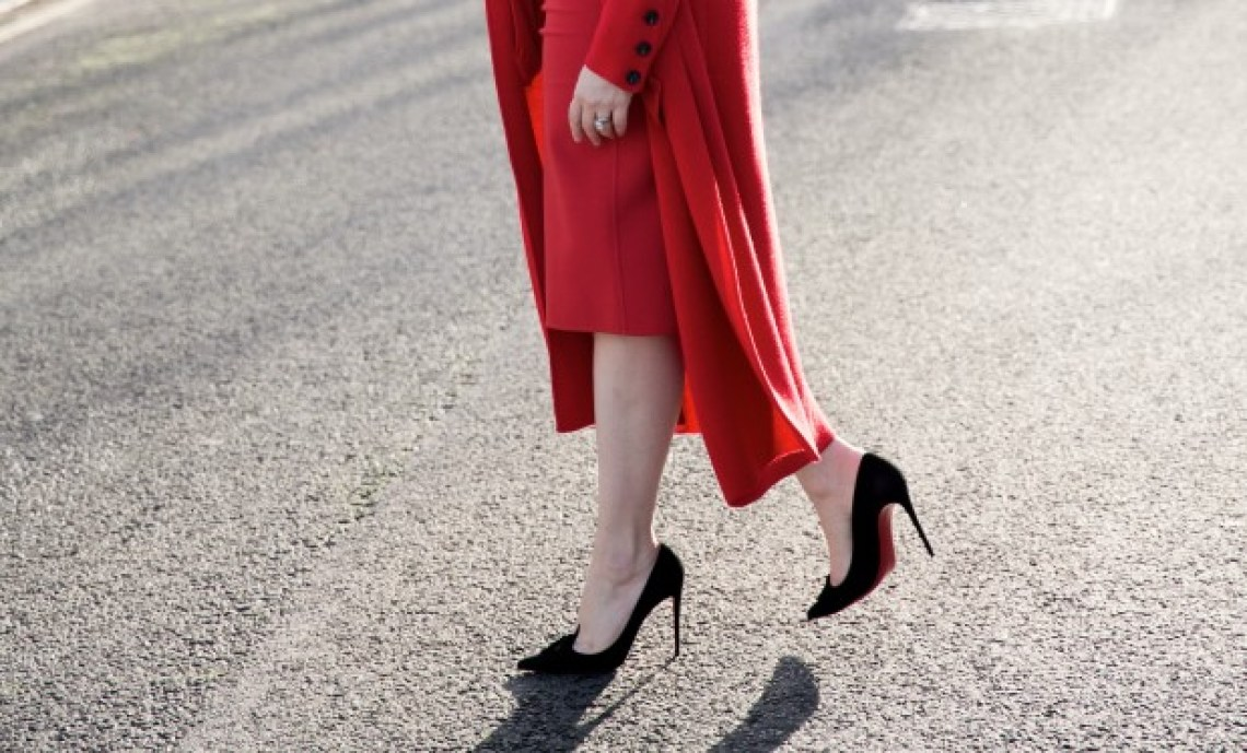 Red Winser coat and Louboutin heels