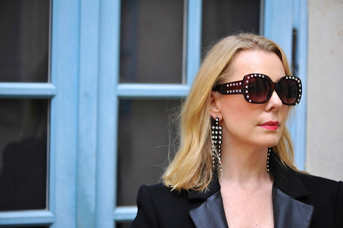 Statement sunnies and earrings