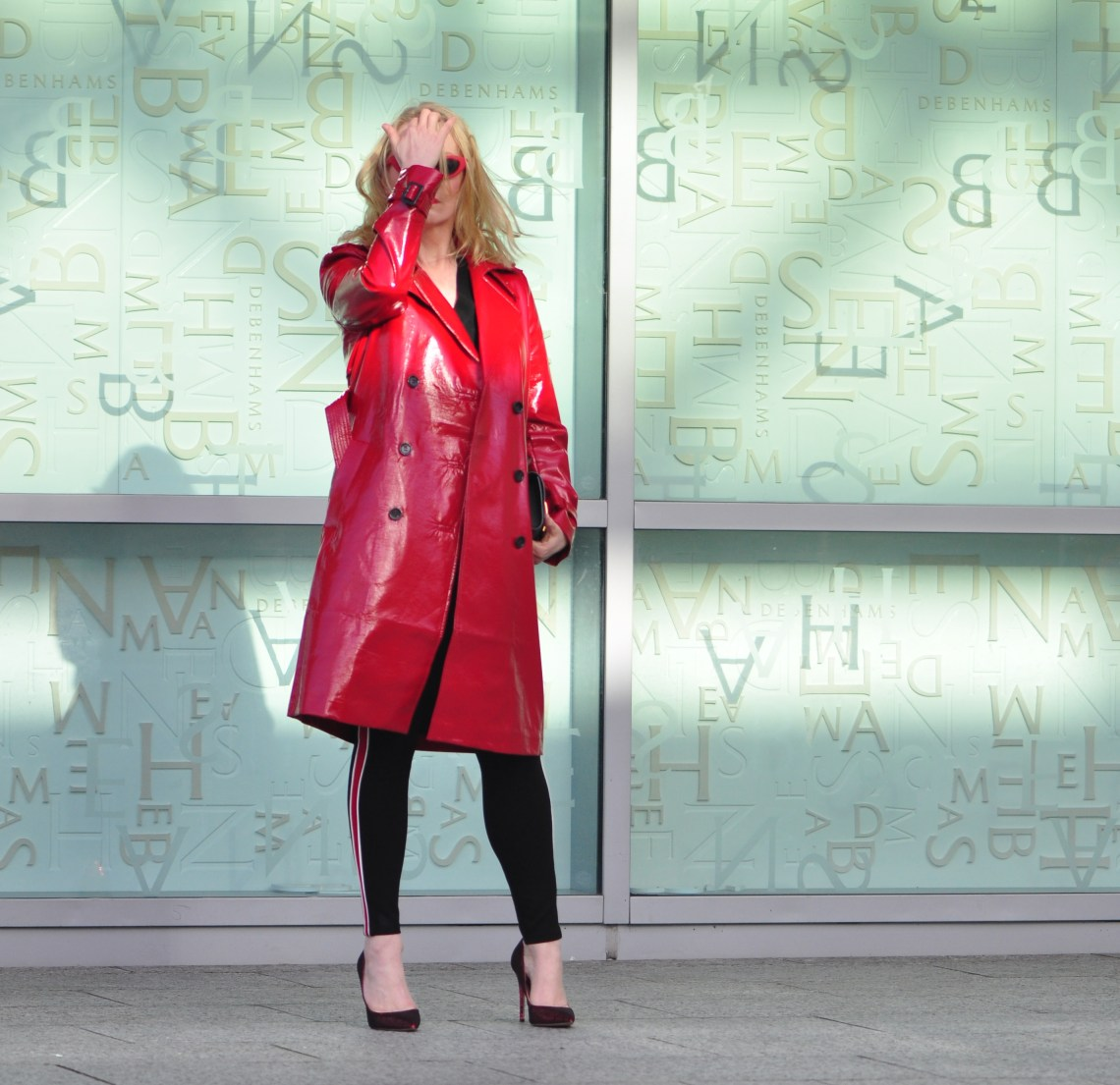 Red PVC trench facepalm