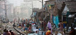 Slums develop near exposed railway lines