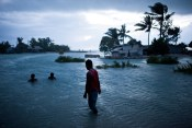 High tide regularly floods roads on Kiribati — a common occurrence that may be further exacerbated by sea-level rise caused by the expansion of warmer water and the addition of new water from melting ice. (© Ciril Jazbec)