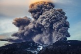 A volcano erupts in Iceland, spewing Greenhouse Gases into the atmosphere.
