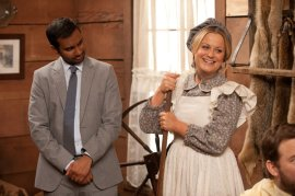 """PARKS AND RECREATION -- """"Article Two"""" Episode 519 -- Pictured: (l-r) Aziz Ansari as Tom Haverford, Amy Poehler as Leslie Knope -- (Photo by: Colleen Hayes/NBC)"""