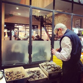 Shucking oysters at Les Halles