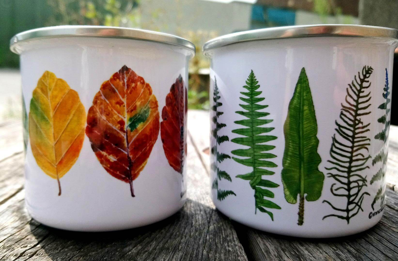 alice draws the line enamel mugs