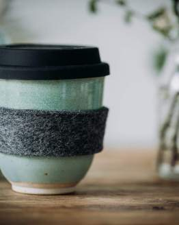 light green travel coffee cup