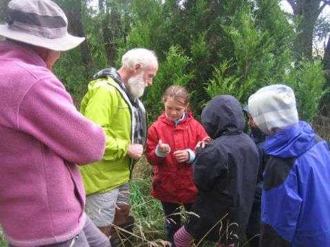 Students learn from Hugh Wilson at Hinewai Reserve