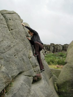 Valerie climbing Lamb Slab Right on The Lamb boulder at Burbage South Valley.