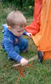 Leo enjoys helping pitch the tent.