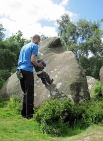 Leo enjoying climbing a boulder at Cratcliffe without using his hands.