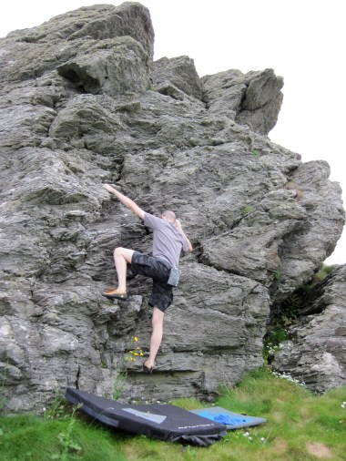 Bouldering on the little crag above Lon Isallt Bay.