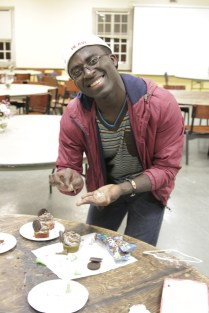 A student makes cupcakes