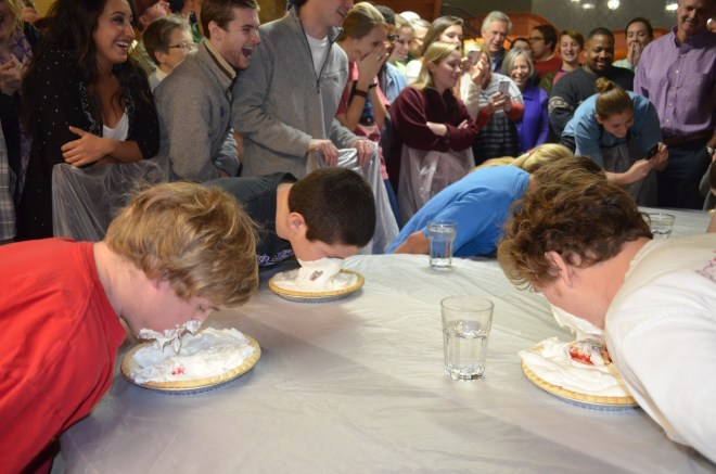 Teams aprticipate in teh pie eating contest