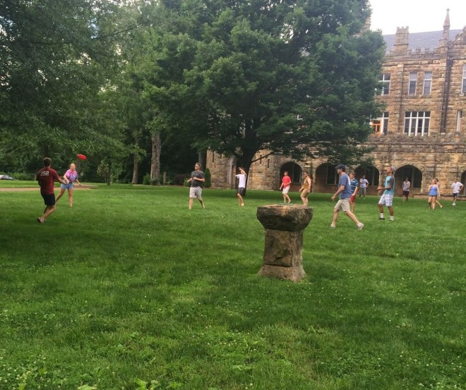 Playing ultimate frisbee on the quad