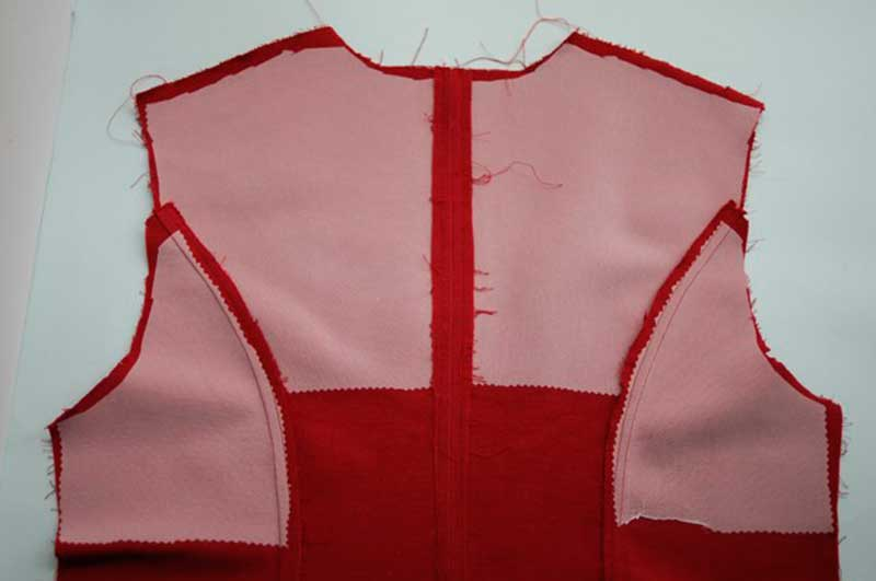 Photograph of the back of a coat with interfacing to form a back stay