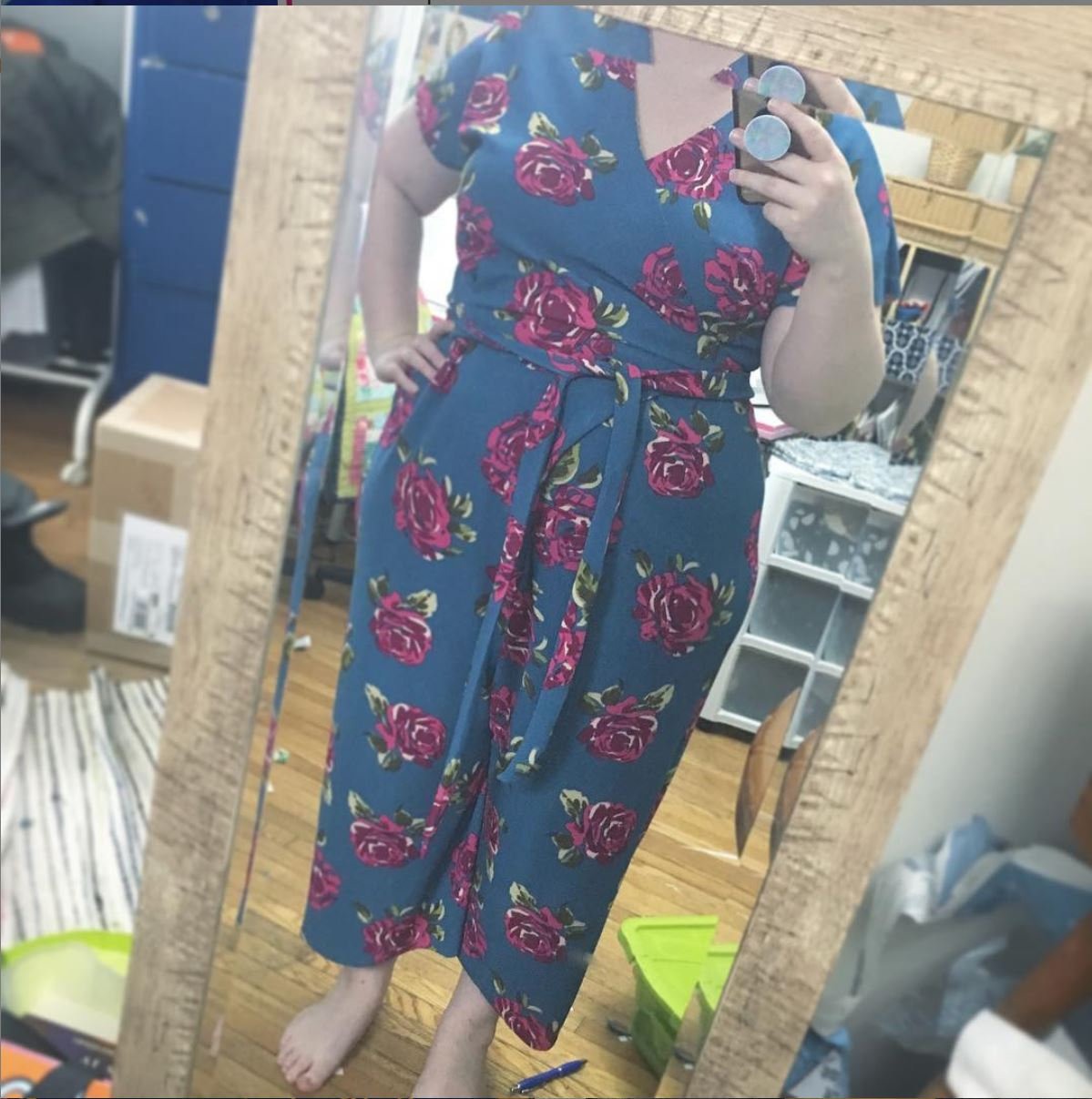 Blue jumpsuit with red flowers on it