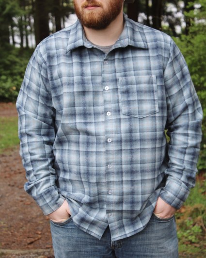 A picture of a man in a plaid shirt.