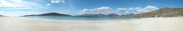 Luskentyre Beach - a huge expanse of white sand and turquise water, with the hills in the background.