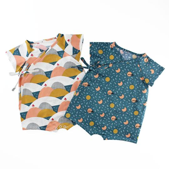 Picture of two baby rompers from Oh Me Oh My Sewing patterns in patterned fabrics.