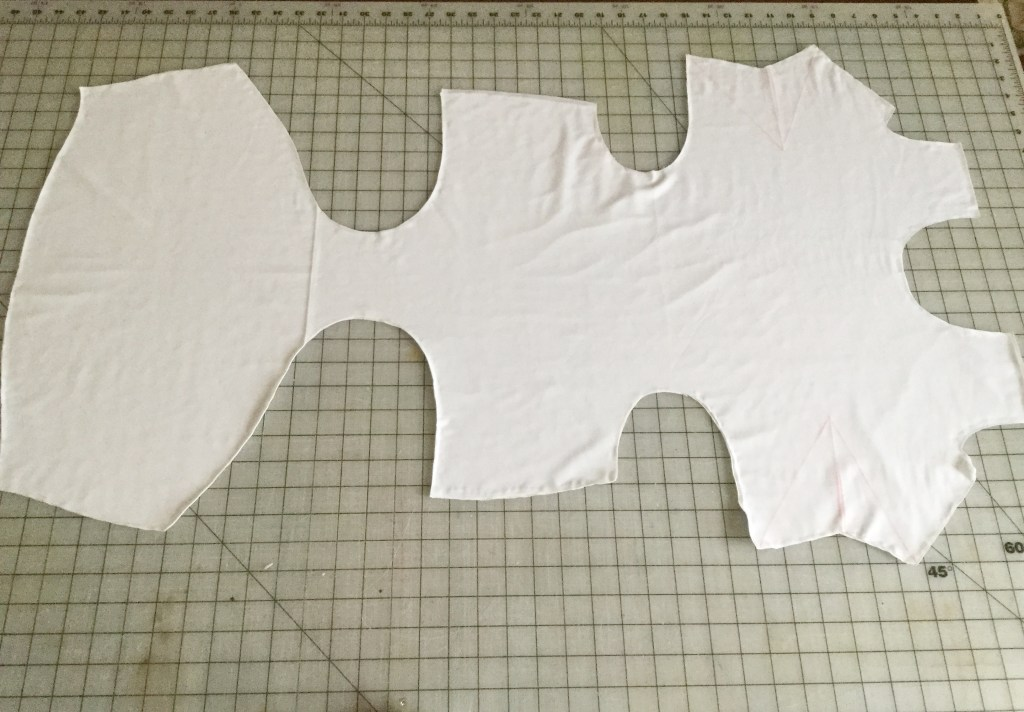 Photo of cut out fabric with underlining attached and darts drawn on.