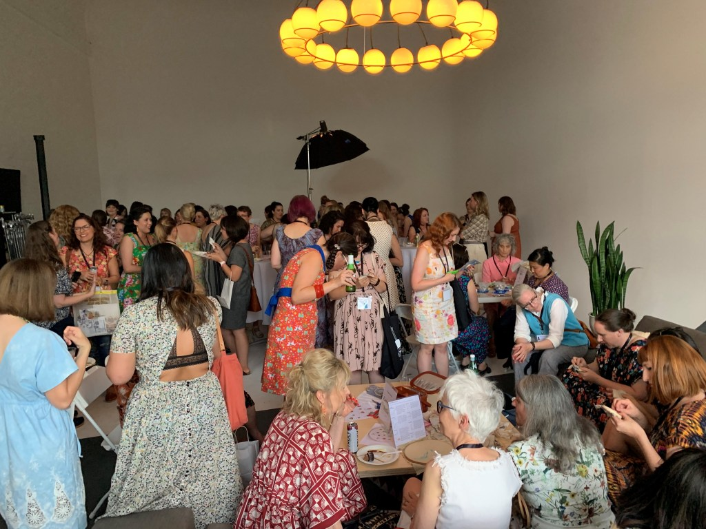 candid shot at Portland Frocktails show about 70 people dressed in self-made outfits socializing