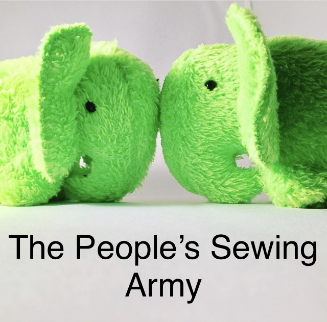Two bright green plush elephants face each other, against a neutral background.
