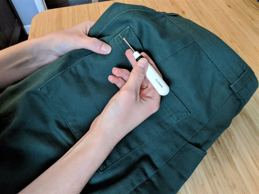 Using a seam ripper on the Lander pants back pocket