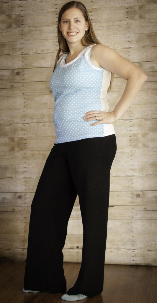 Person modeling a light colored polka dot tank top and black leggings