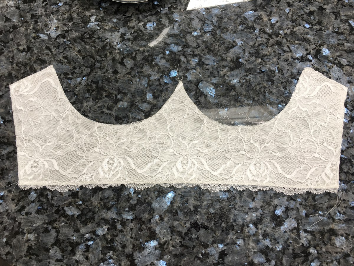 Bra cradle with both pieces attached. Lace on top of the lining fabric.