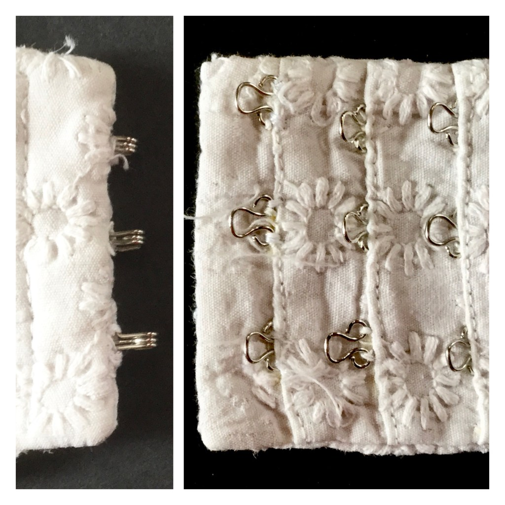 White hook and eye closure using white embroidered fabric and silver hooks