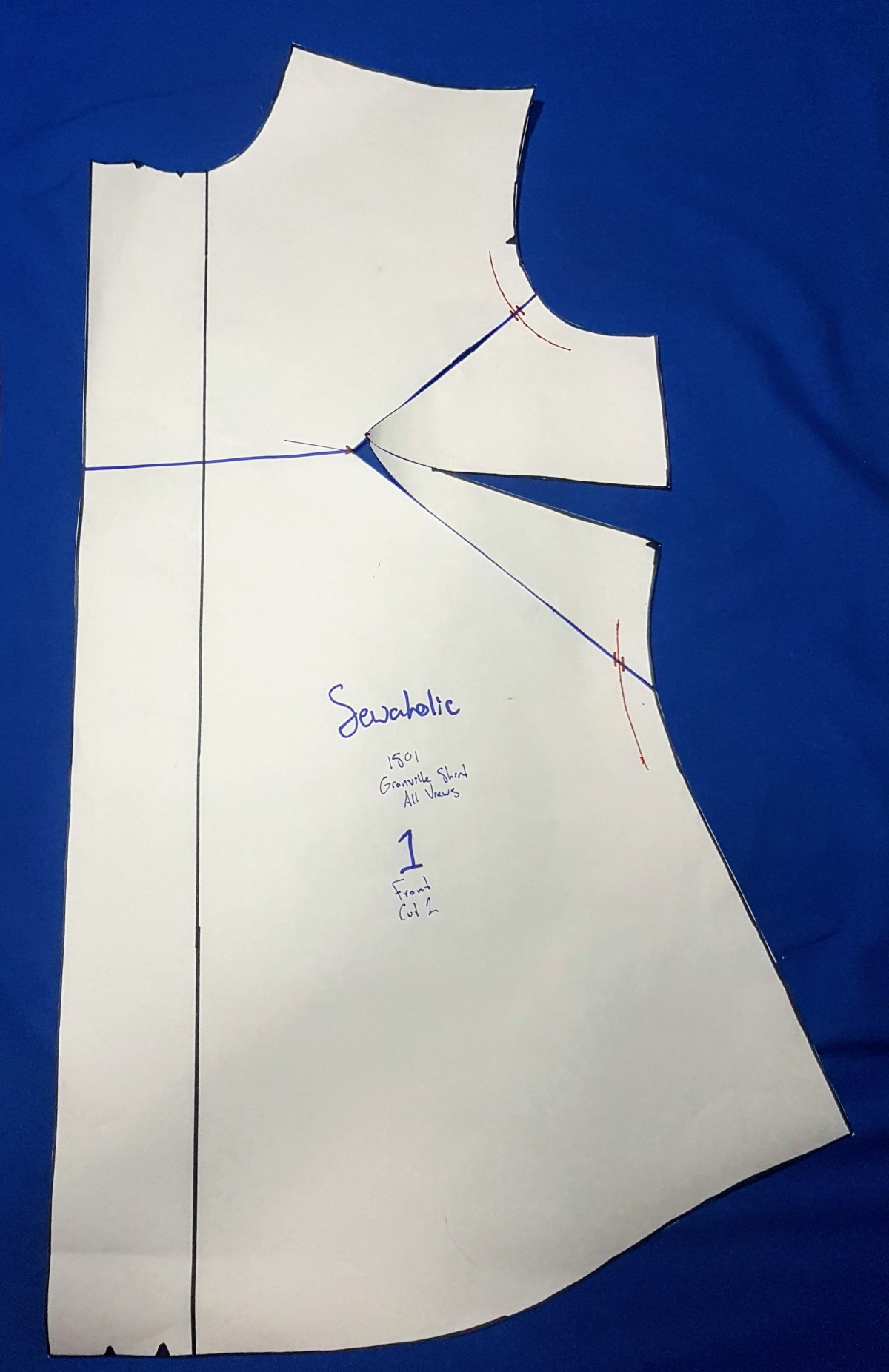 Front pattern piece with blue marker lines drawn in the manner described above.