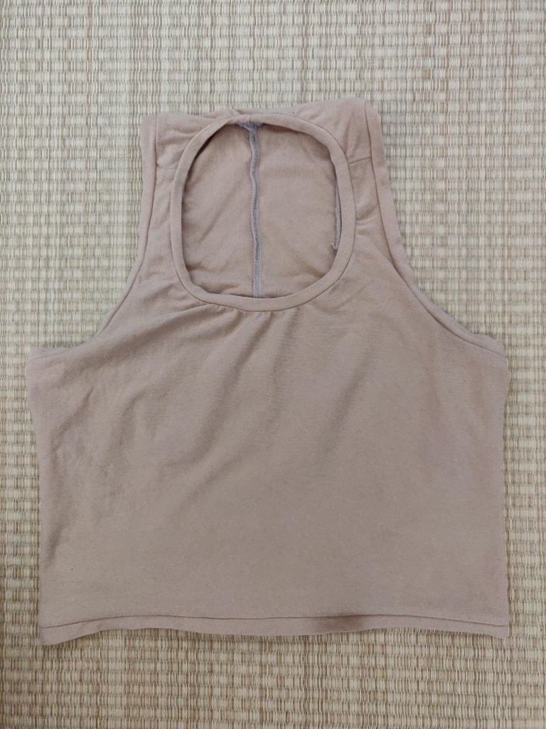 A flat-lay of of a second tank, this time in a tan cotton lycra jersey.