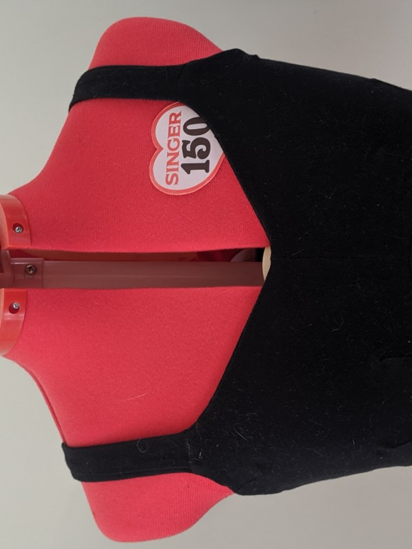 A dressform showing a completed Lovesick bra in black cotton lycra, size 12C.