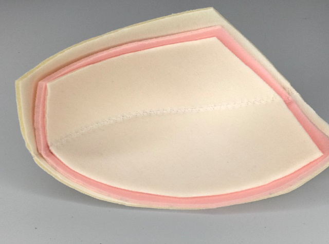 Three graded bra cups nestled inside each other