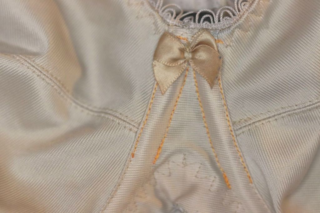 At the centre gore of the bra, from the outside, the new lines of machine stitching are nearly invisible.