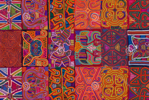 Eighteen different examples of molas (six per row), with red, pink, yellow, and green being the dominant colors. The molas have curvilinear forms, repetition, and symmetry of design