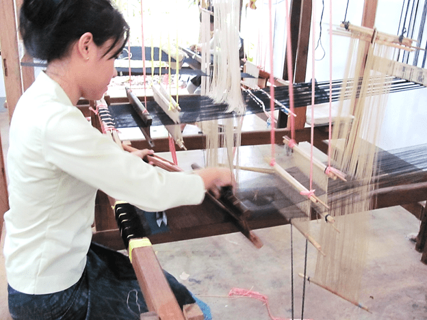 Image of a woman using a loom