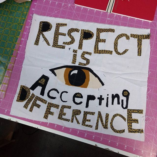 "Quilt square that says ""Respect is accepting difference"", with dark text on white background."