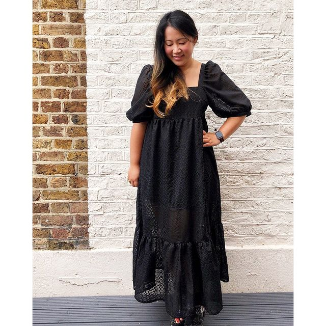 Emily wearing the Mindy Dress pattern by Fibre Mood in a black floral cotton burnout fabric.