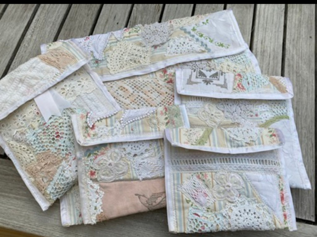 A selection of gift bags made from fabric and lace scraps.