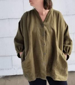 woman wearing a moss green jacket/shirt