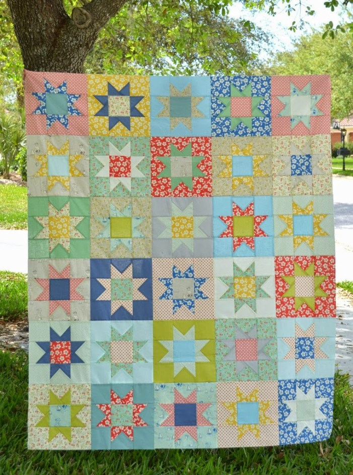 bright summery handmade quilt top with stars the sewing chick