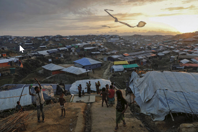 Rohingya refugee children fly improvised kites at the Kutupalong refugee camp near Cox's Bazar, Bangladesh (Part of Reuters series that won Pulitzer for feature photography)
