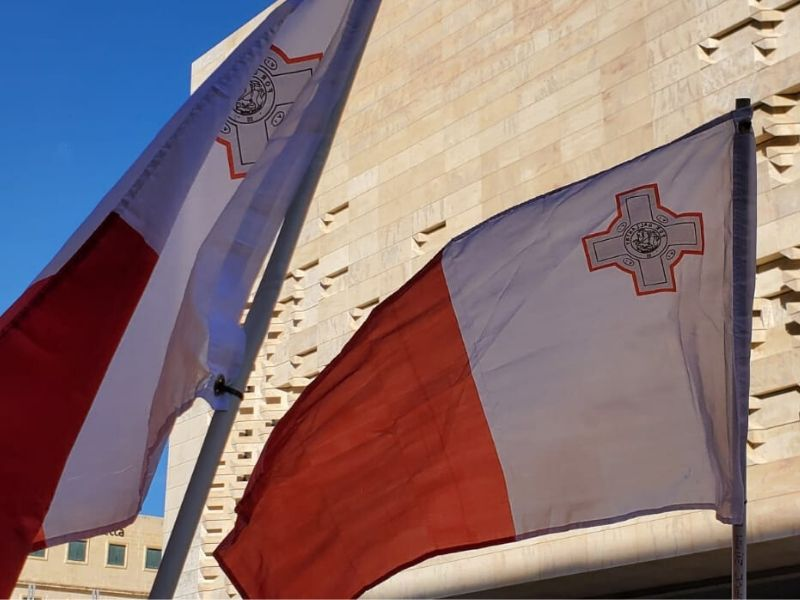 Citizens held Maltese flags in a protest in front of parliament on 22 June, 2020.