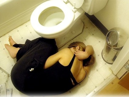 Woman laying on floor because of alcohol withdrawal