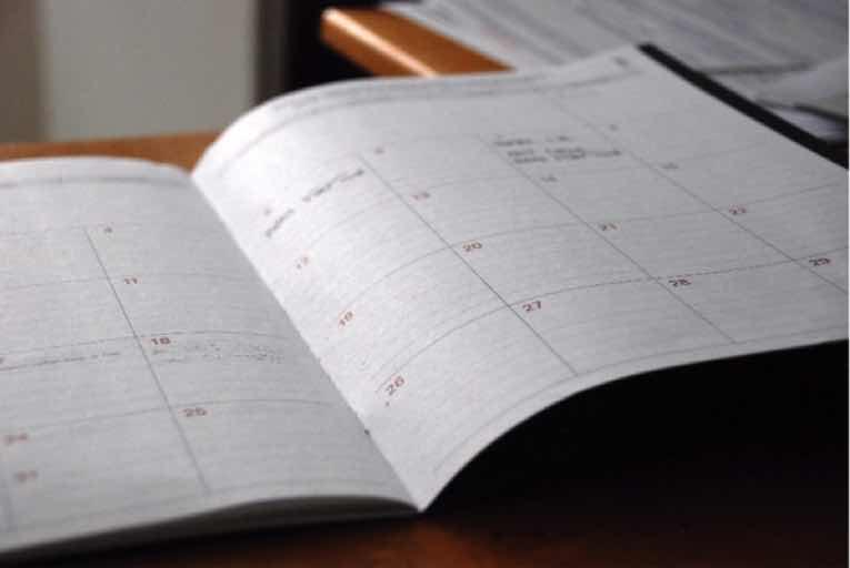 A calendar open on a table.