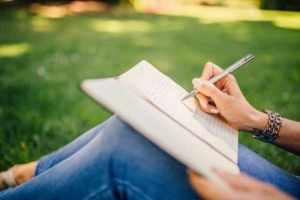 women writing in book