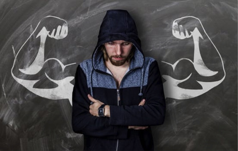 Man with arms drawn trying to prevent a relapse