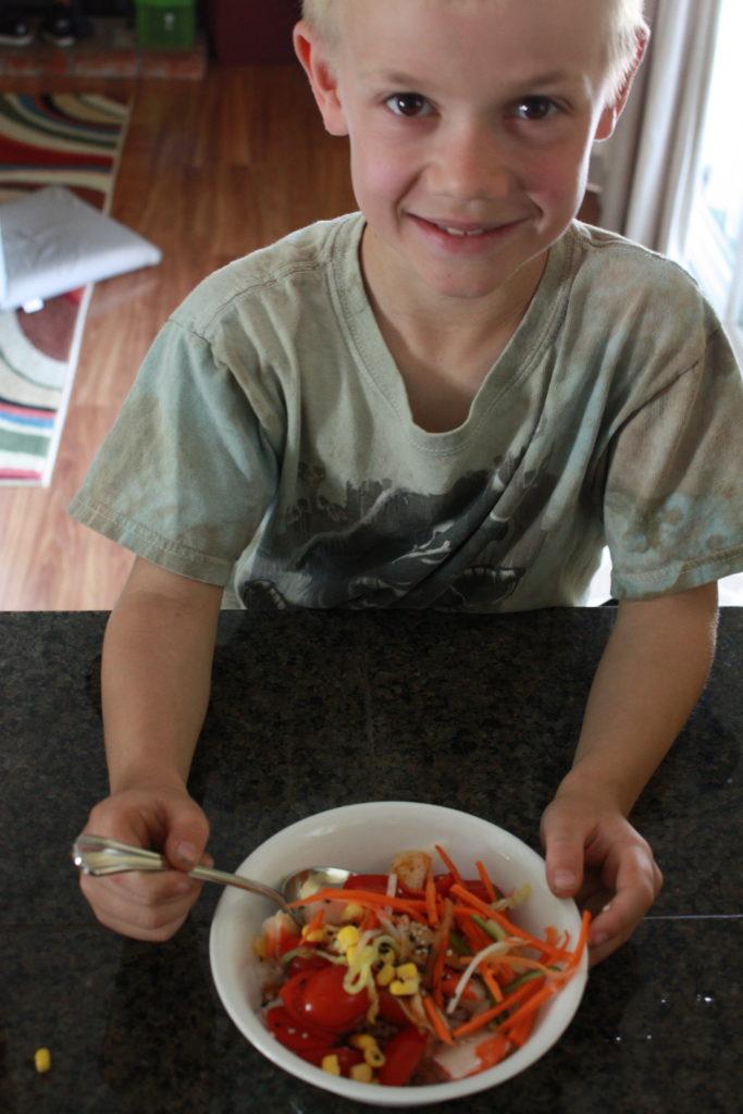 Landon showing off his bowl of poke